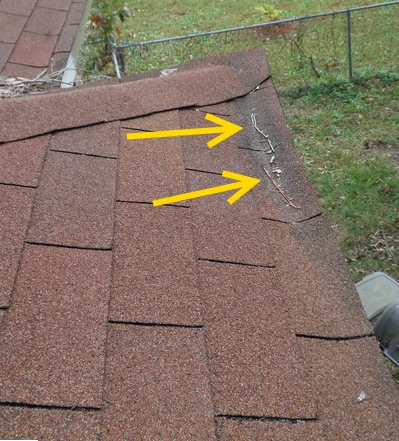 dip in shingles at fascia on charleston home